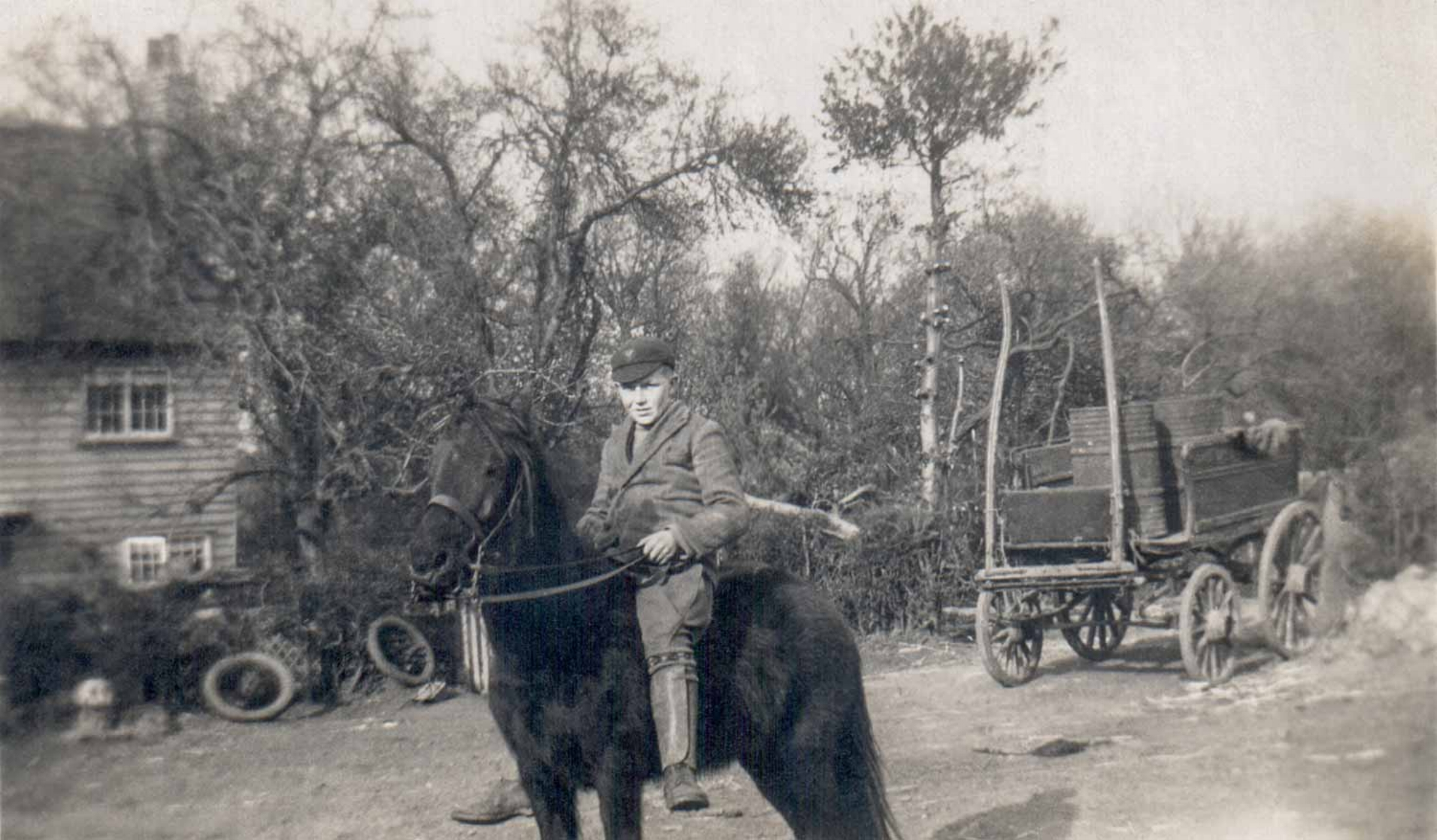 Outside Unknown rider outside Greens Farmhouse.  The card was used for collecting waste food for boiling into pigswill.  Kindly reproduced by permission of Betty Jacobson nee Watts