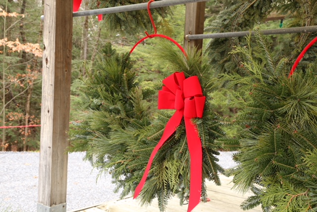 red ribbon half wreath outside.JPG
