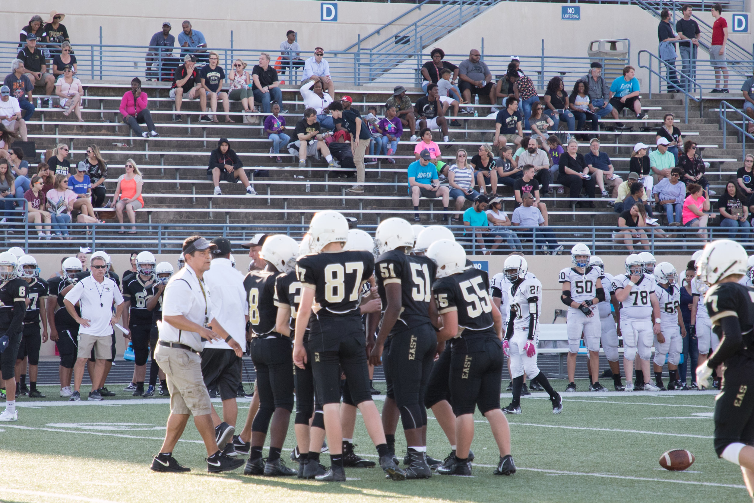 2-Coach Martinez huddles the players before a play.jpg