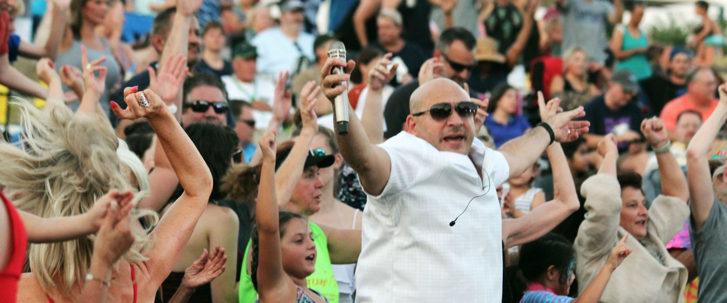Deno Taglioli, founder and lead singer of Emerald City Band, rocking with the crowd.
