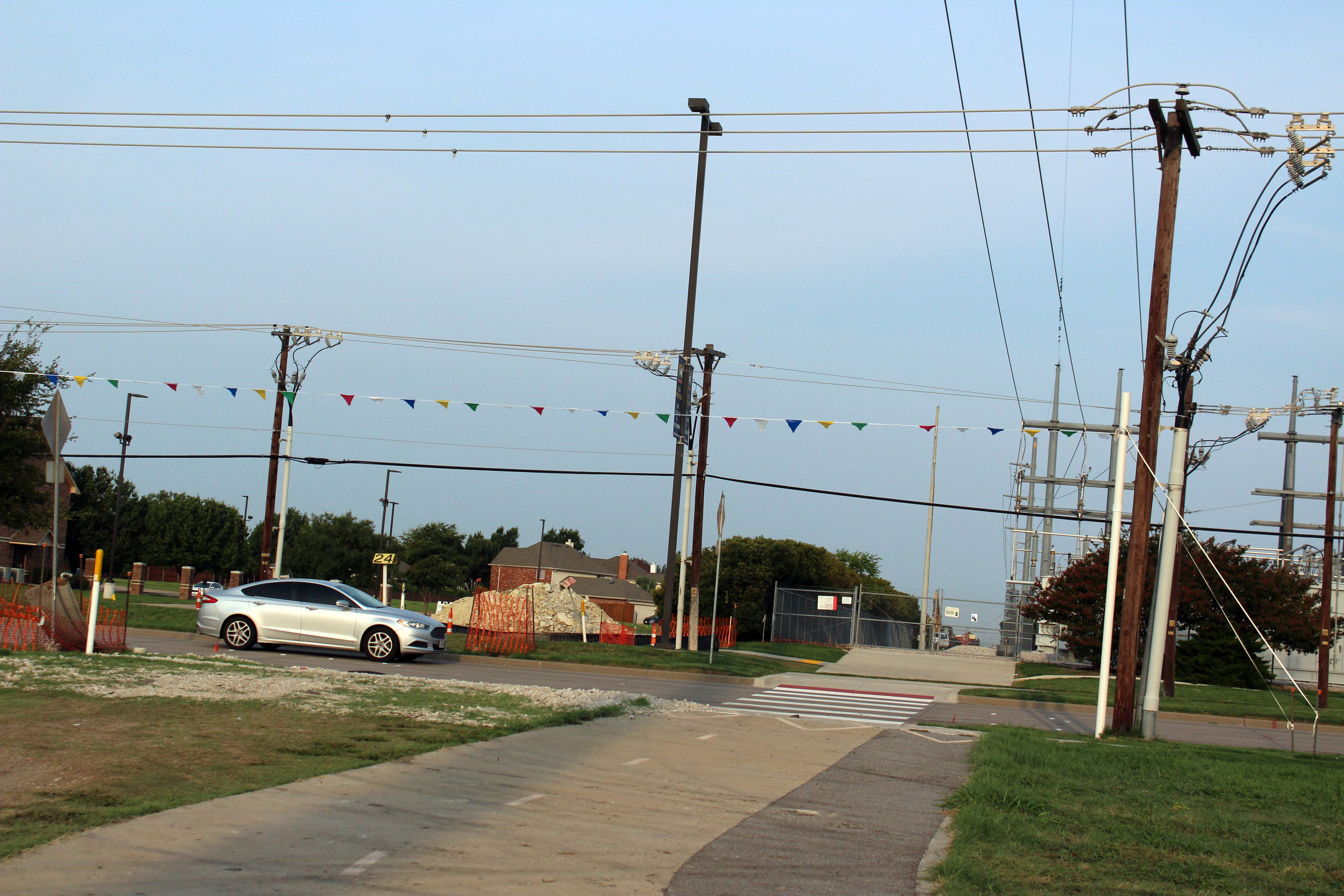 """Goal posts"" are installed for large equipment operators to signal a low power line crossing."