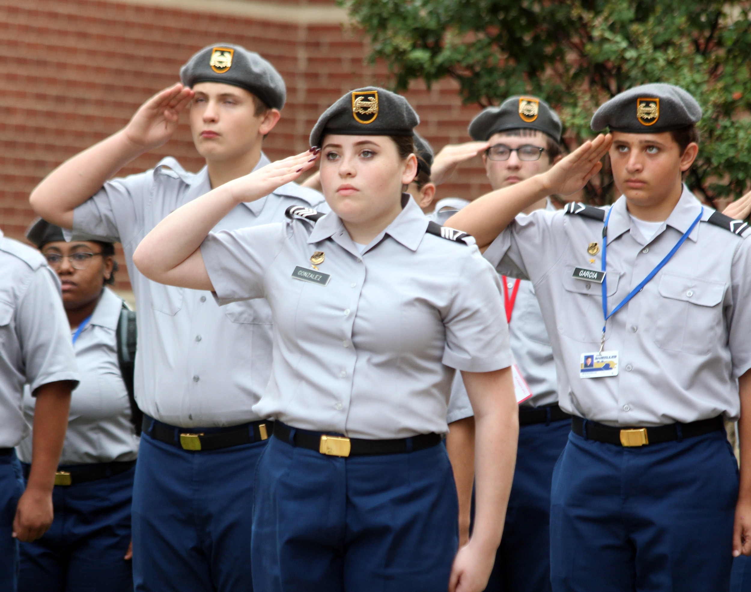 Members of McMillen's ROTC program raised the flags to half-staff.