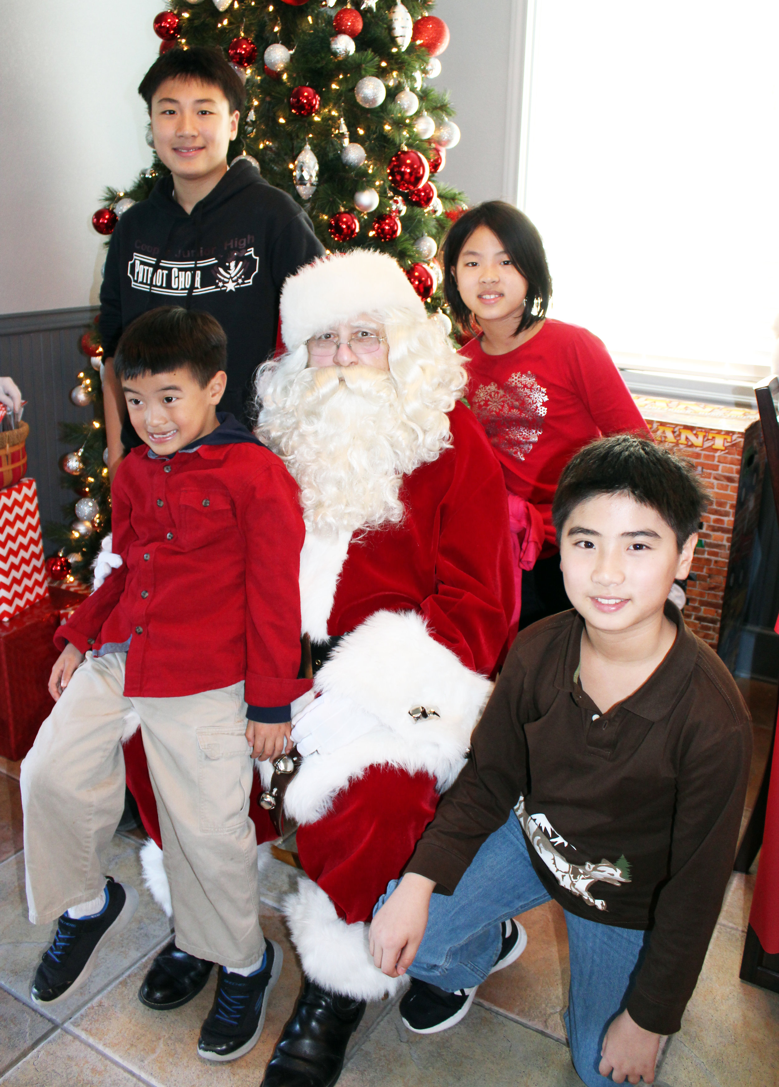 The Wang children (Front row, from left) Cody and Sevy, (back row, from left) Leon and Suri.