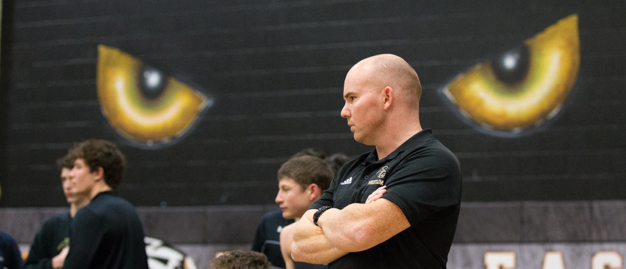 PESH head coach Bryan Kenney watches a match vs Lovejoy