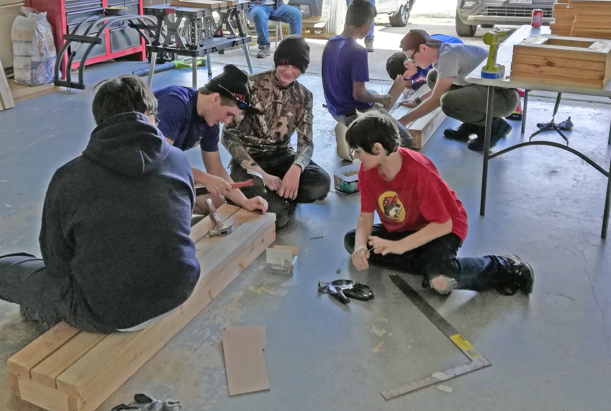 Troop 198 scouts building the planter benches.