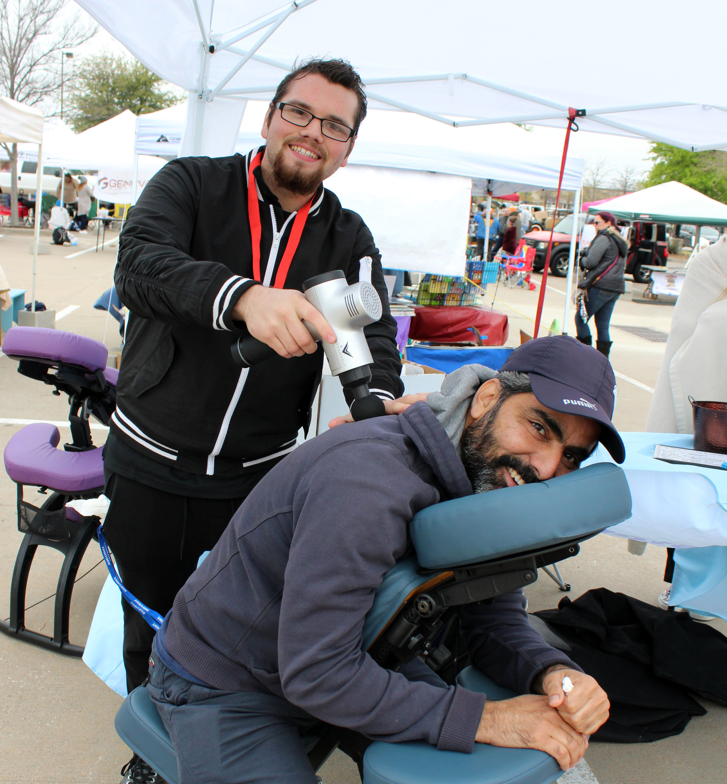 Masroor Mirza enjoys a complimentary massage given by Travis Anzaldua, a therapist at Massage Envy in Murphy.
