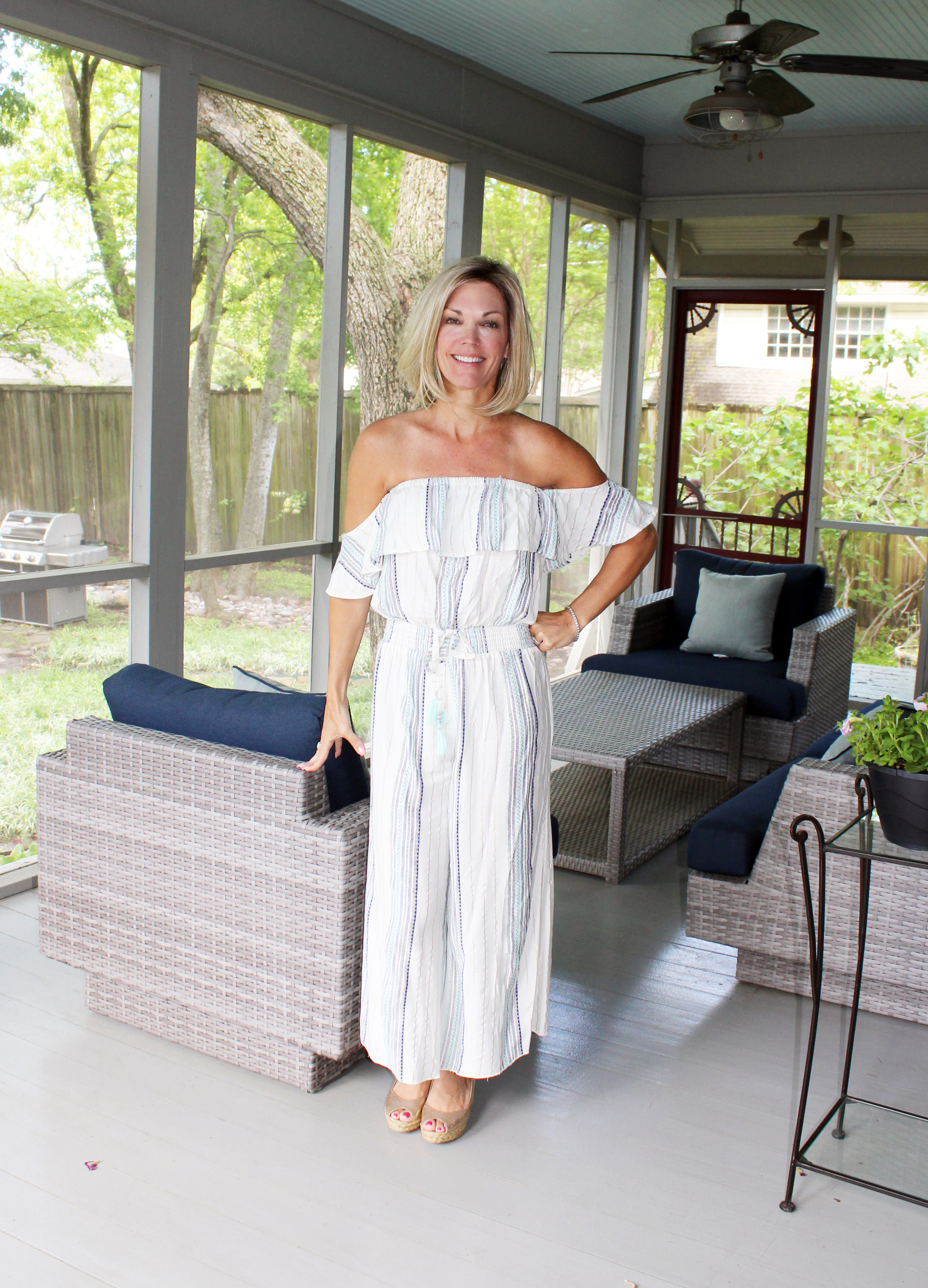 Colleen Frost stands in the highly-favored screened in porch.