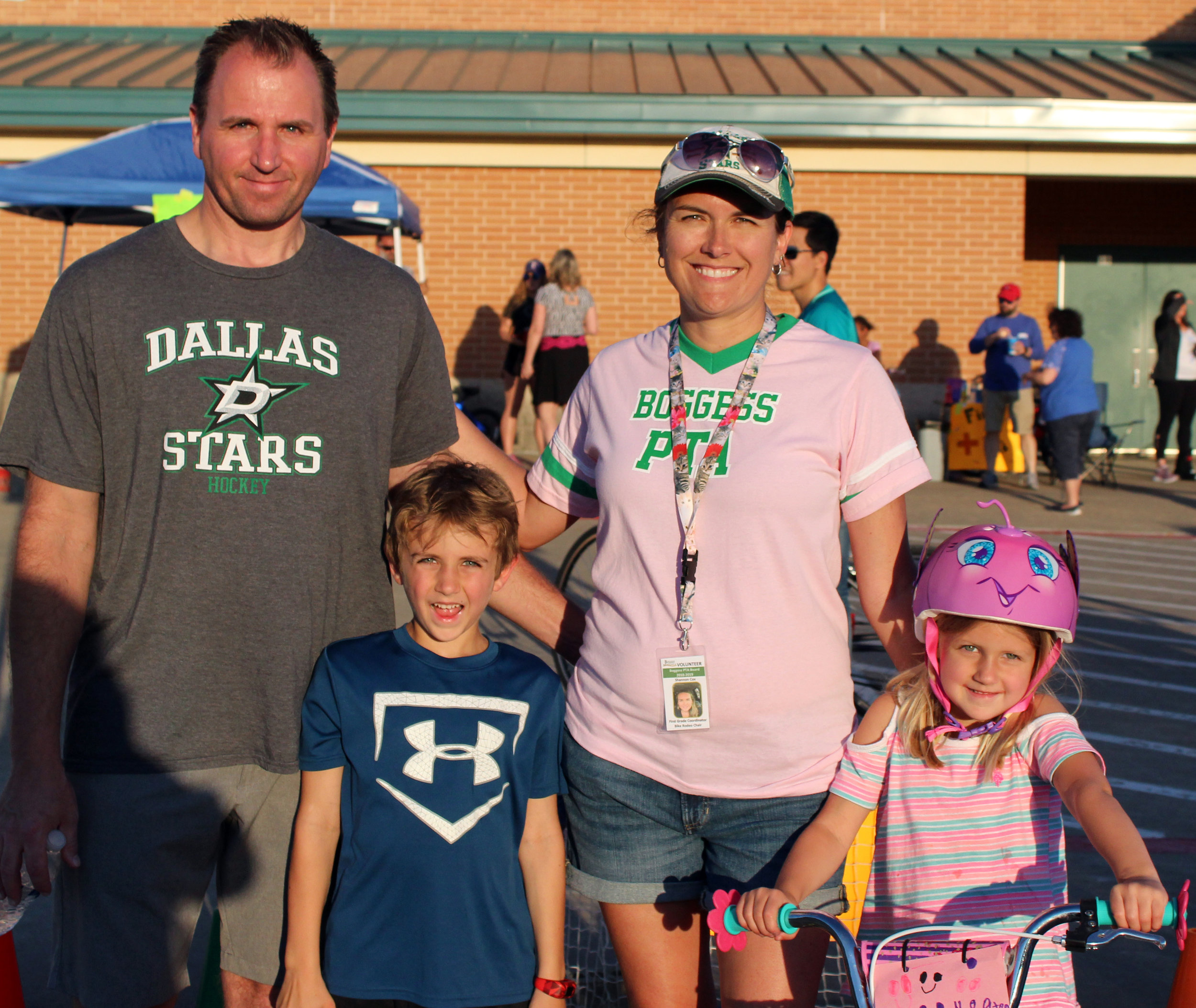 (Front row, from left) Lachlan Cox, Keaton Cox, (back row, from left) Shane Cox and Shannon Cox, Boggess Bike Rodeo chairperson.