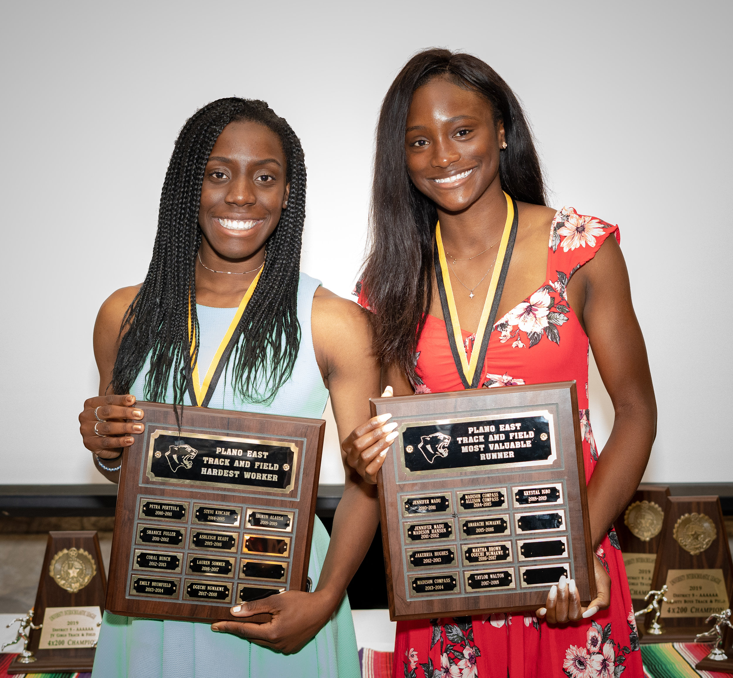 Ibukun Alausa (Hardest Worker) and Krystal Igbo (Most Valuable Runner) are presented with awards.