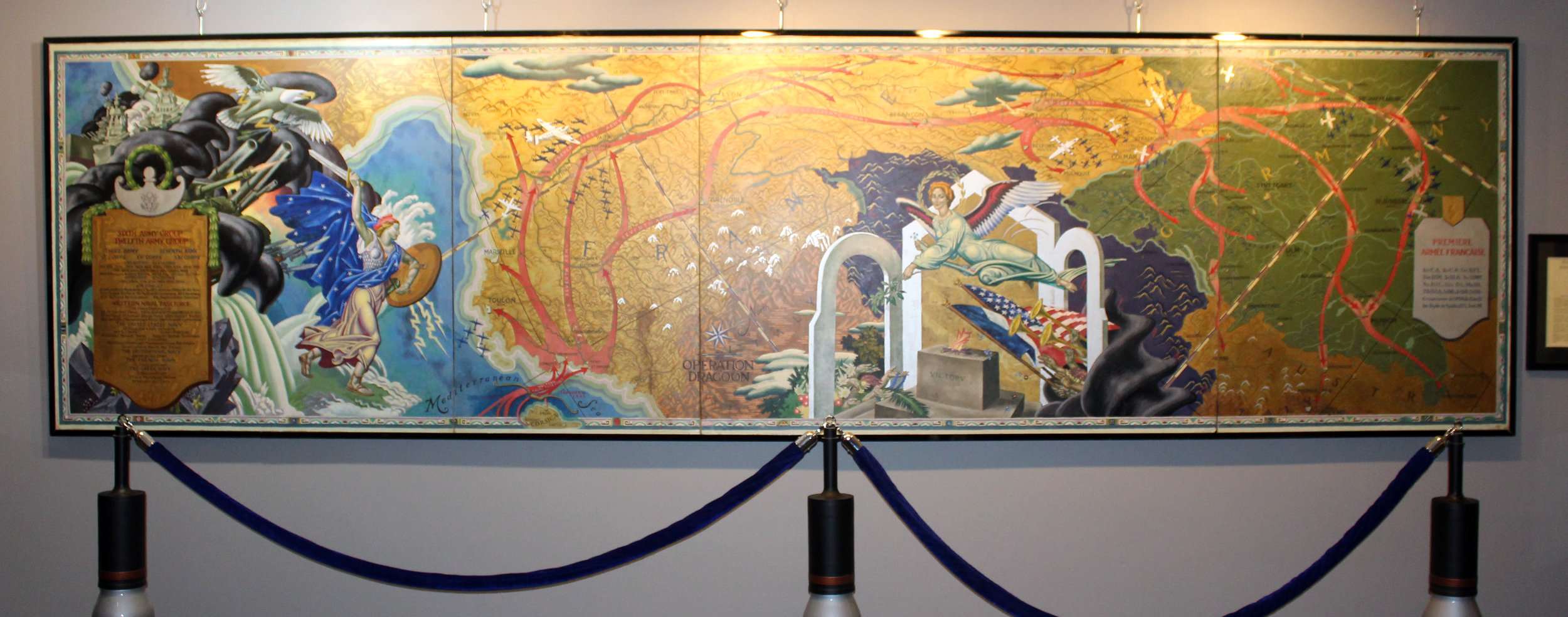 A 15' x 60' mural titled 'Operation Dragoon' by American master Eugene Savage (artist of murals in State Fair of Texas Hall of State). This is one of many military-themed art pieces on display.