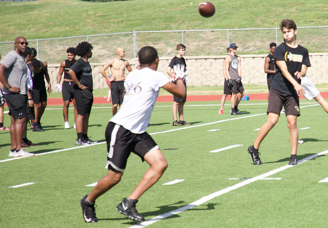 Quaterbacks and Receivers worked together on connecting on routes during the camp sessions..png