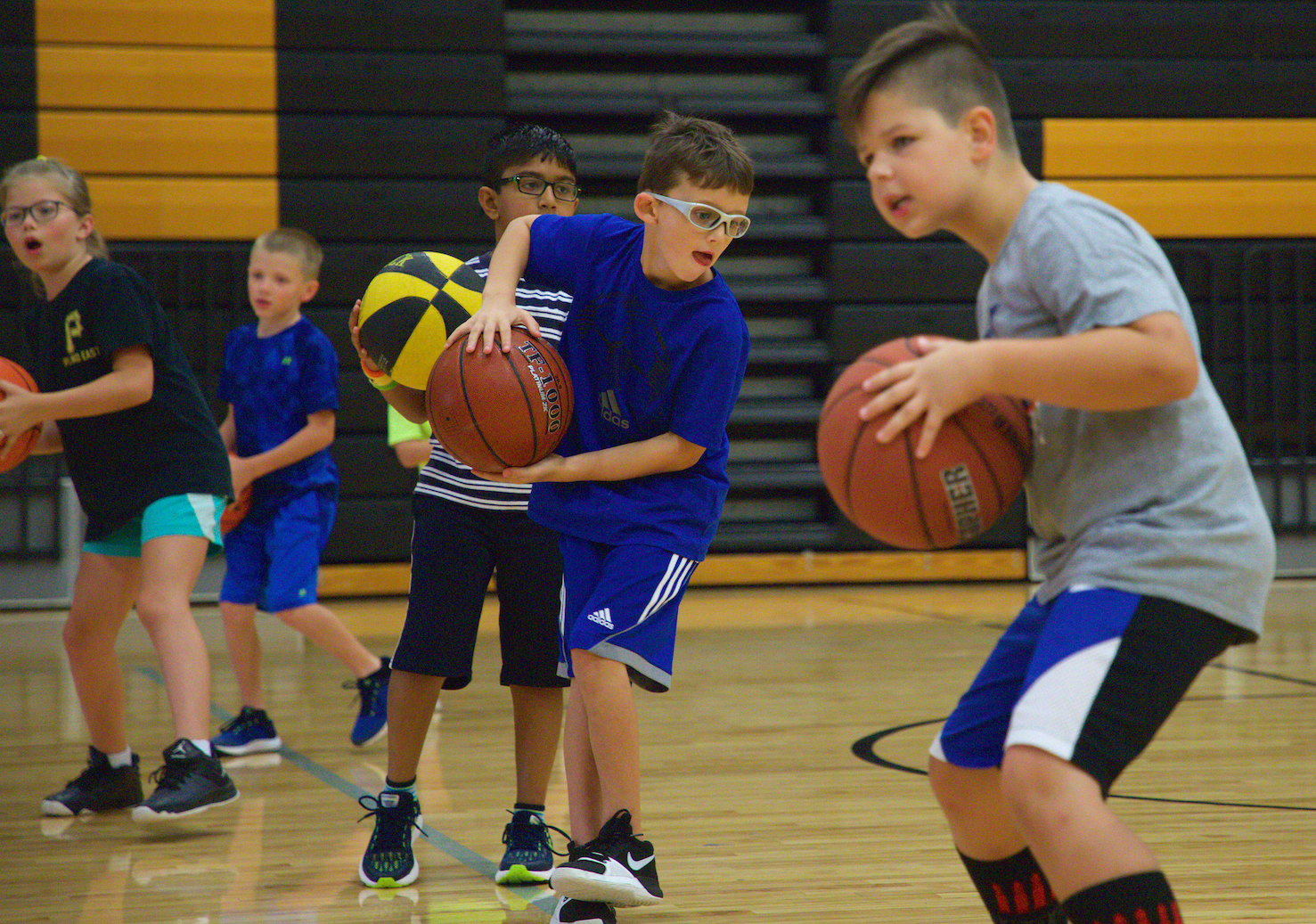 Campers learn the basics of the triple threat postion..png