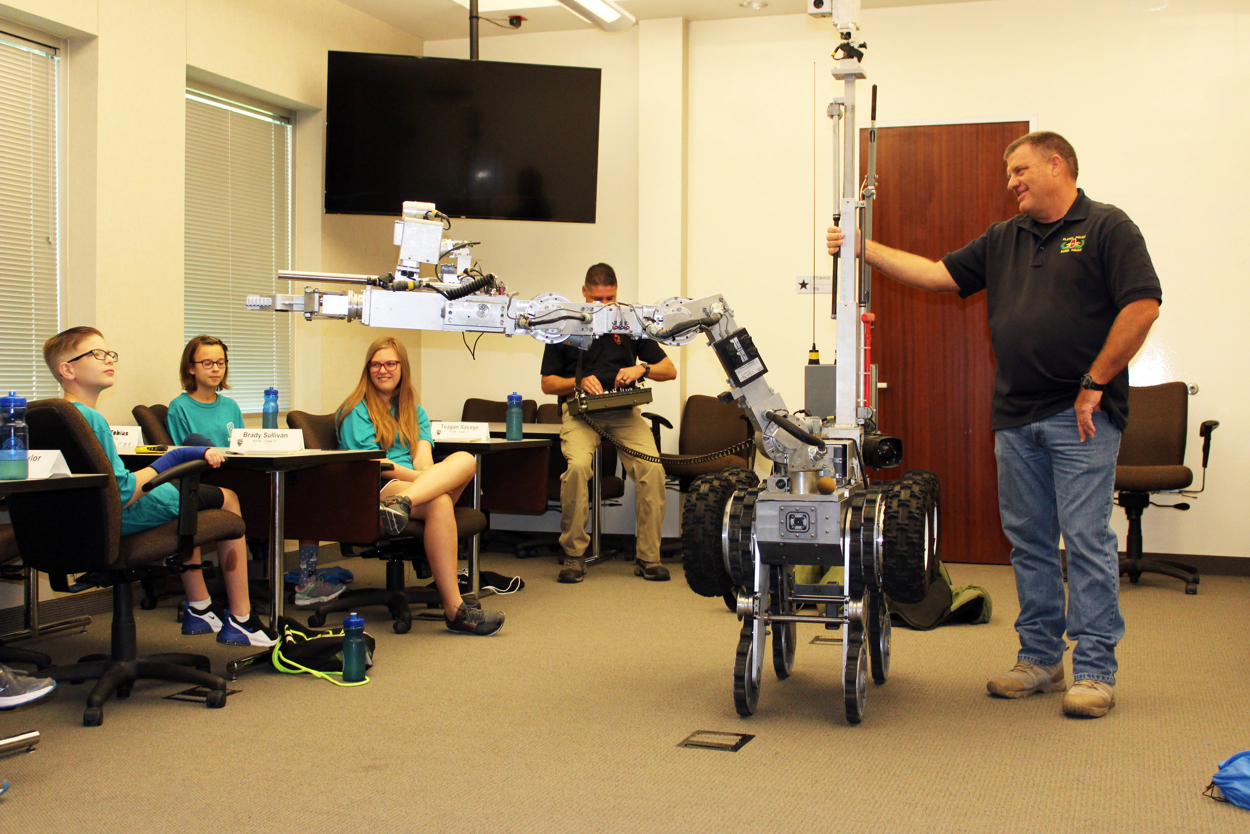 Members of Plano bomb squad demonstrated their bomb robot's capabilities.