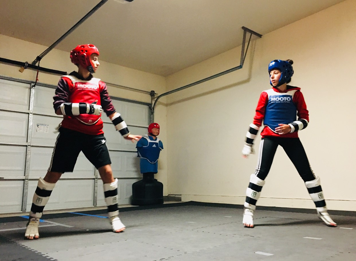 Twins, Sally and Jonah Ismael, are Taekwondo competitors who train together in their garage in Murphy.
