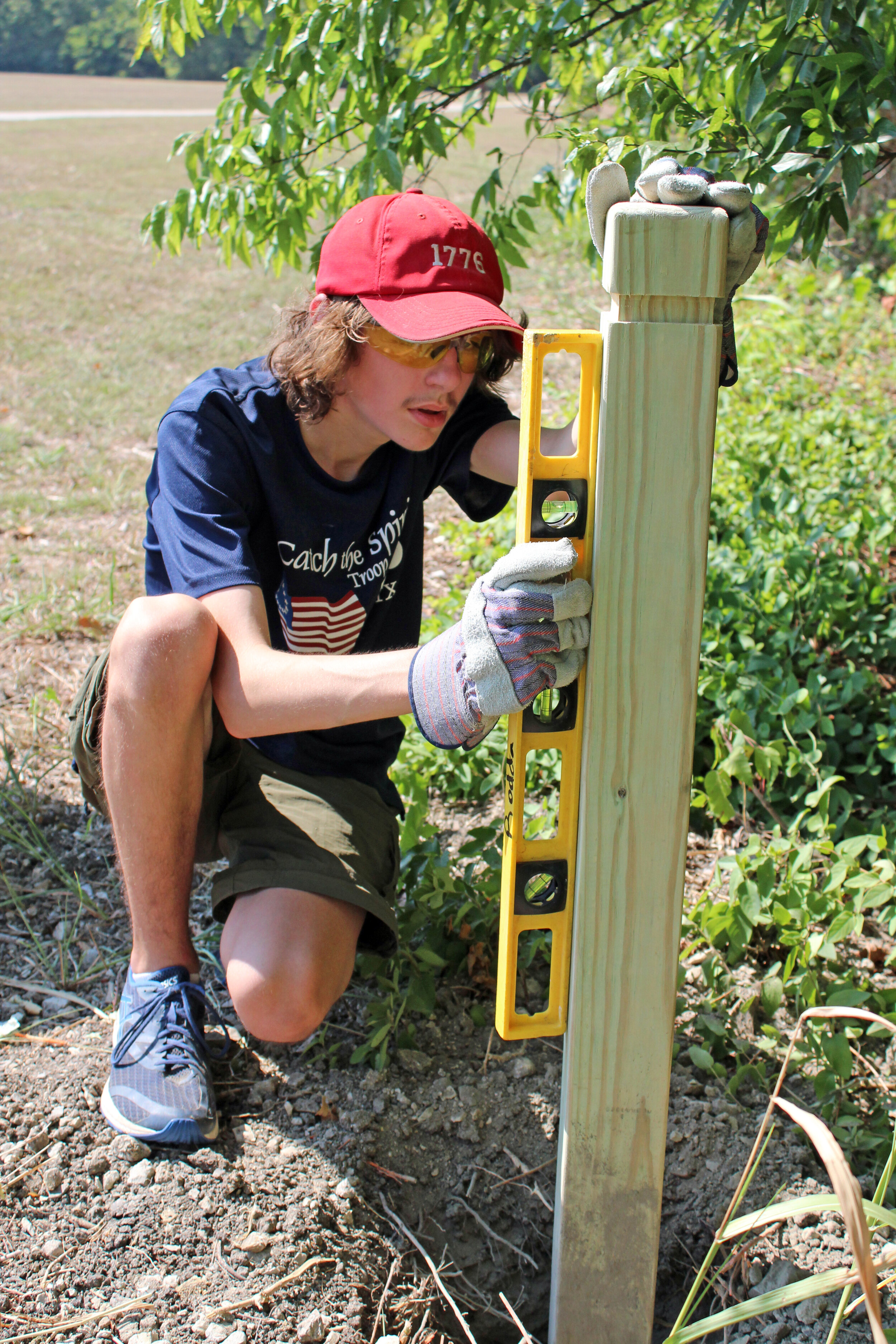 Arik Rodda checking the level of a trail marker located at one of the trailheads.