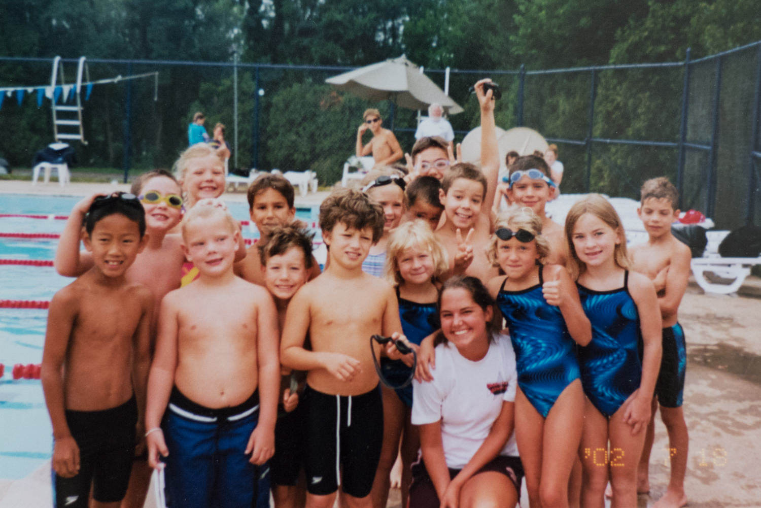 One of the biggest influences in my life has been the Arlington Knights of Columbus swim team. I was a swimmer from age 7 to 18. Then I coached the team for four years. The sense of community on this team is amazing. It's all about helping each other over being competitive. I did a personal project on the team in 2016, and it warmed my heart that the team is still exactly the same. The big kids help the little kids. They teach them to swim and indoctrinate them into the Holy Mackerel customs. The little ones still belly flop into the pool, hang off the big kids and walk around the pool deck wearing their foggy goggles.