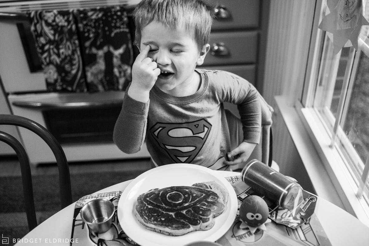 little boy loves his pancake shaped like an eye