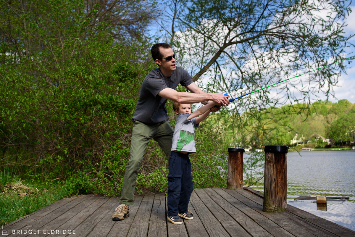dad teaches son how to fish