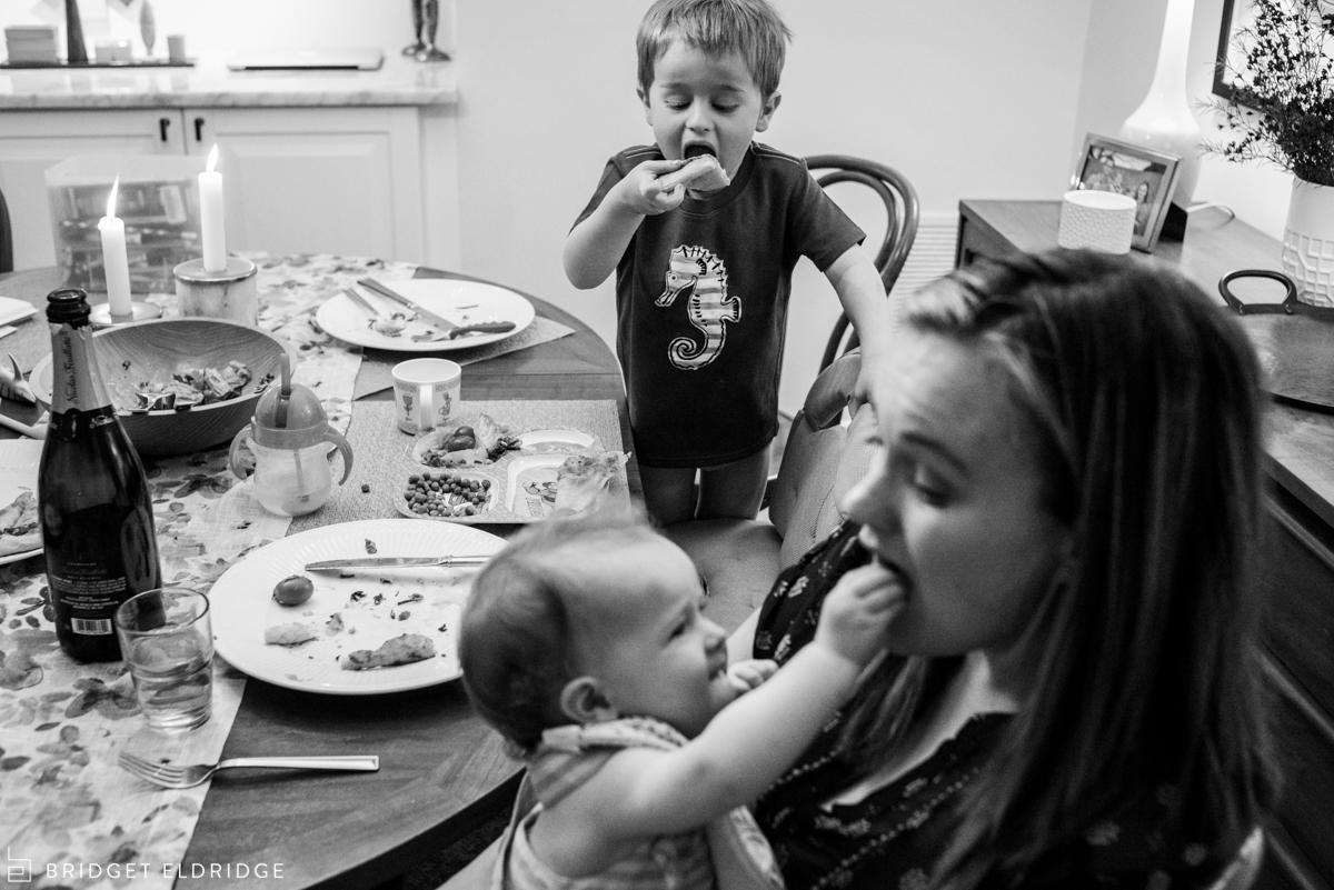 little boy eats pizza in his underwear