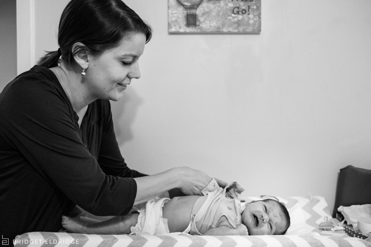 mom changes newborn baby