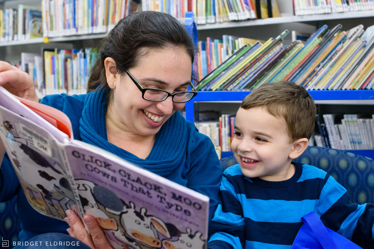 Mom reads her son Click, Clack Moo Cows that Type at Vienna library