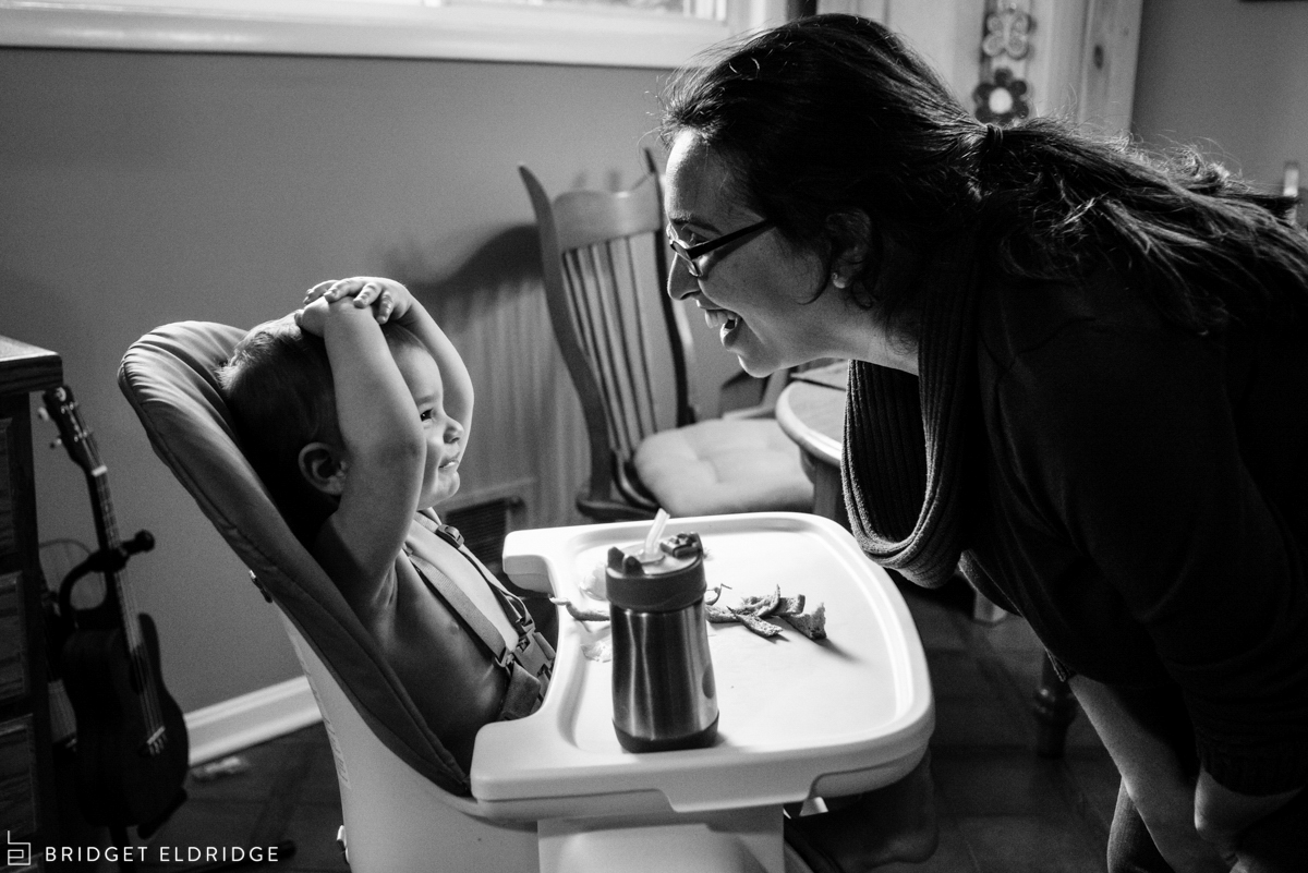 mom and son laugh during lunch