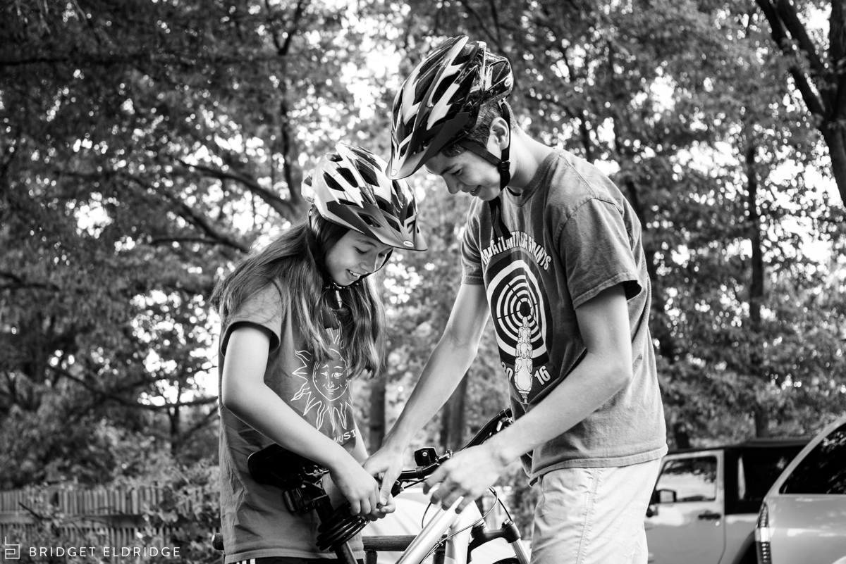 kids check how their bike lock works