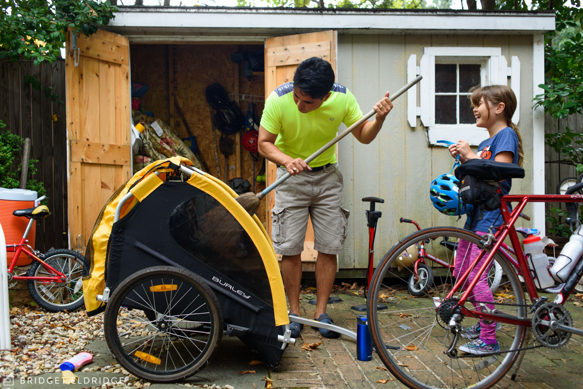 dad gets bikes ready for a family adventure in washington dc
