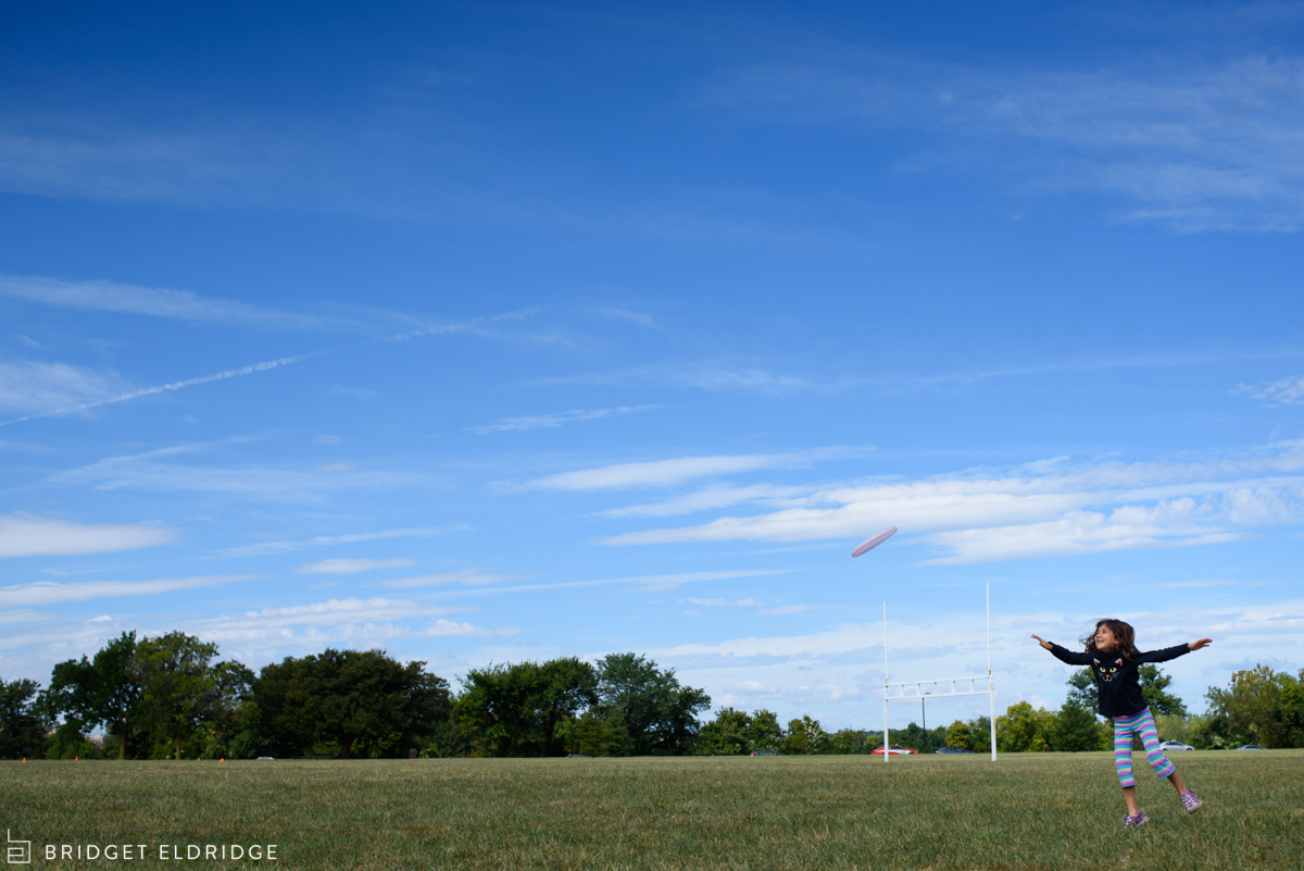 girl catches a frisbee at gravelly point park