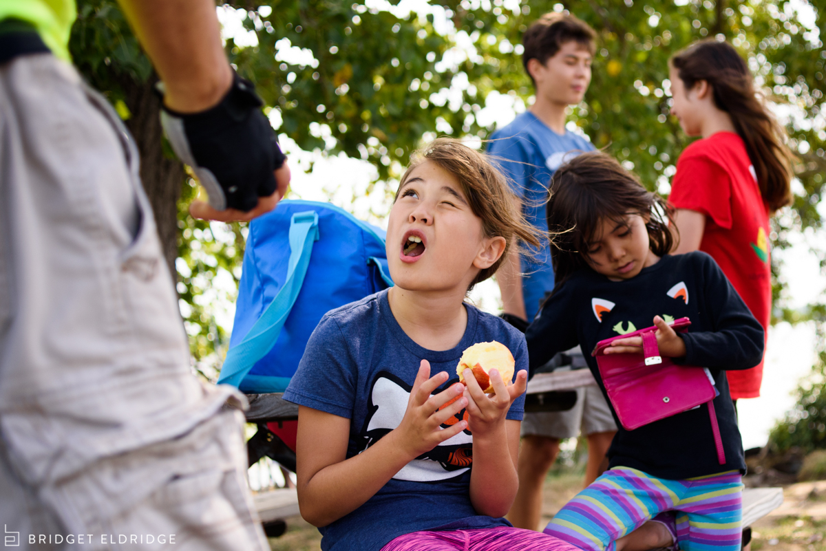 girl eats an apple at gravelly point