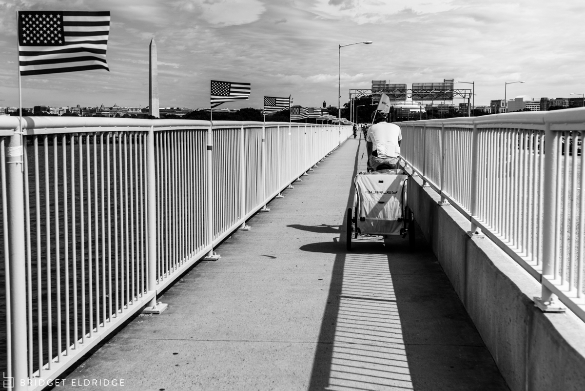 family bikes across the 14th st bridge in washington dc on september 11th