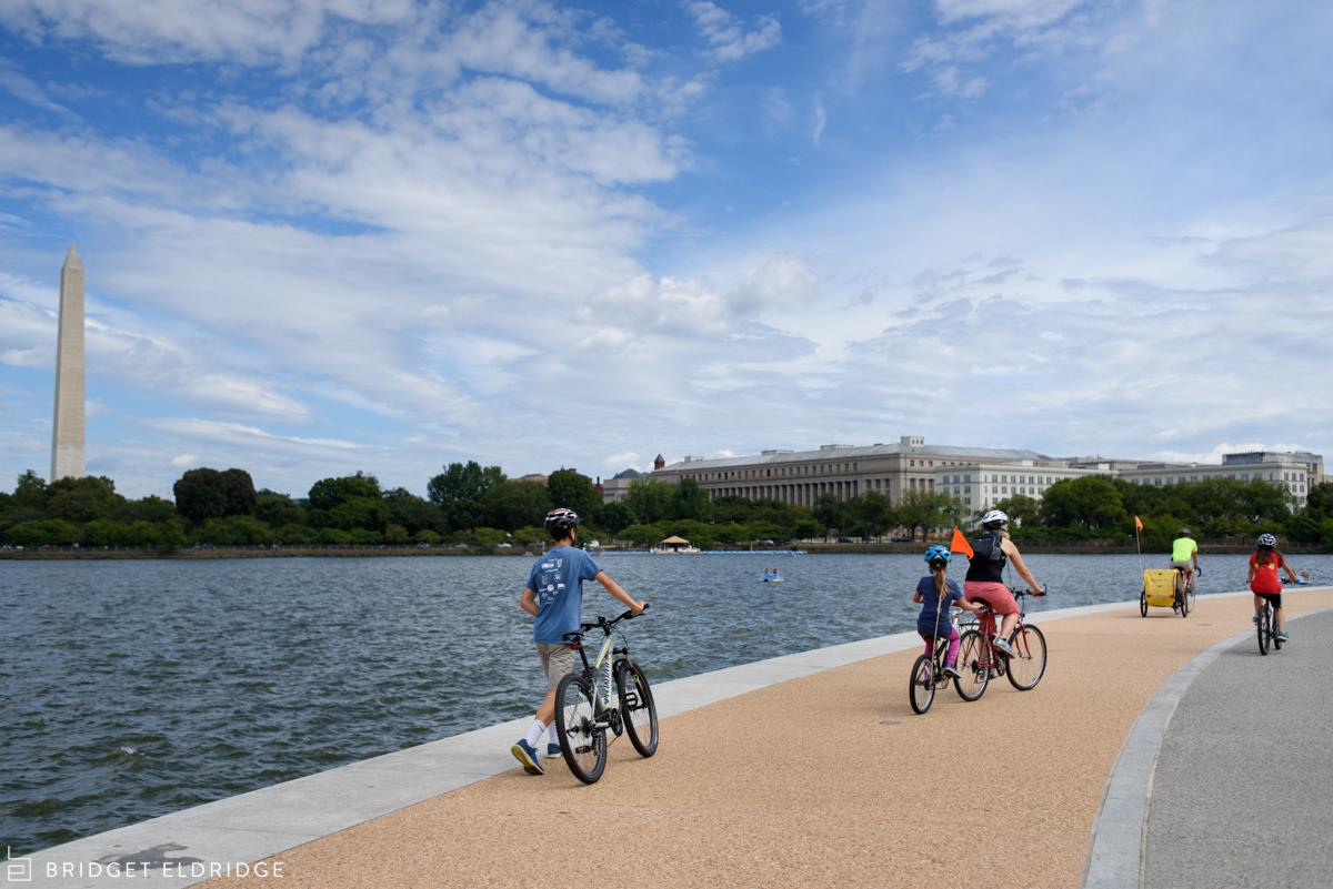 family dismounts bikes at the tidal basin