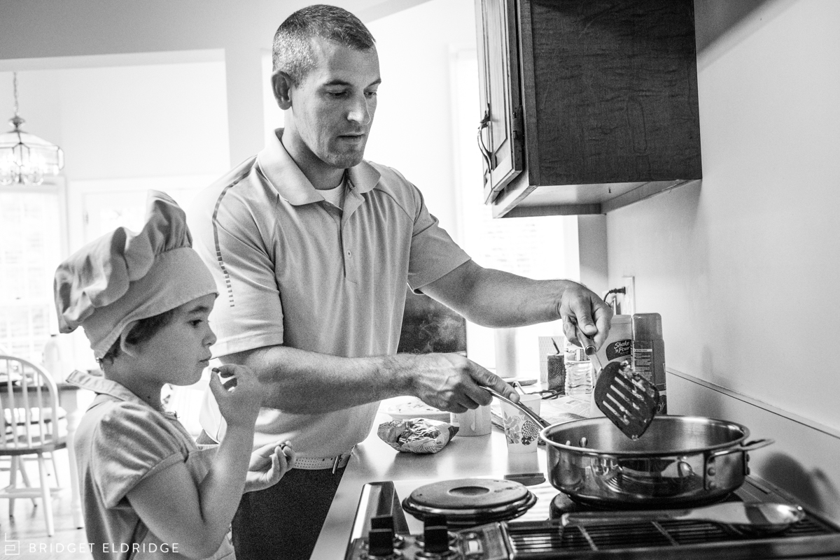 dad and daughter cook pancakes