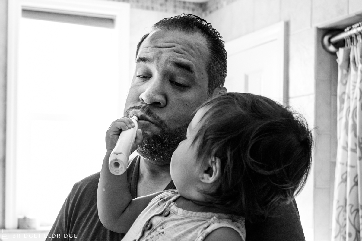 daughter brushes her dad's teeth
