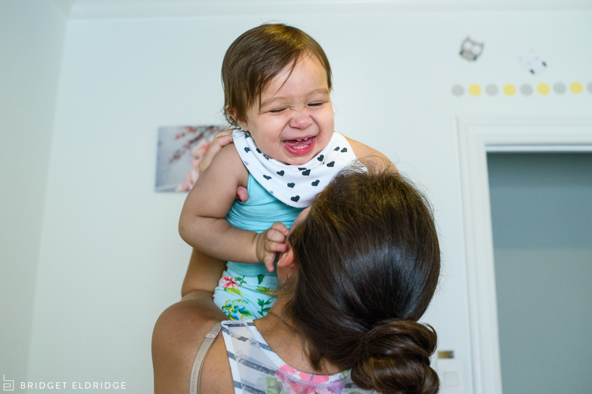 baby laughs with mom after nap
