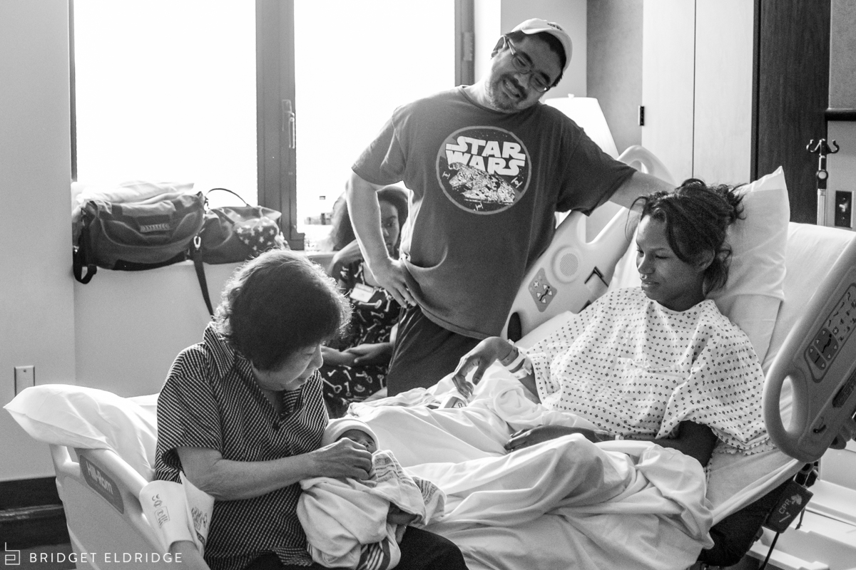 parents look on as grandmother holds her grandson at reston hospital center