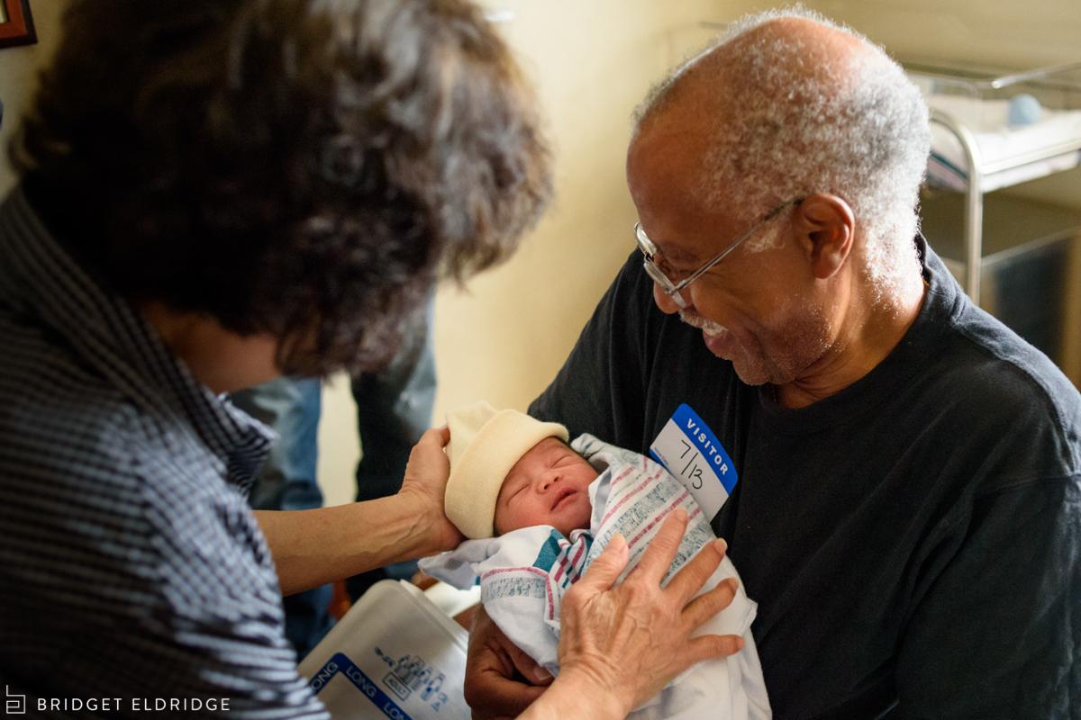 grandmother hands grandfather their grandson