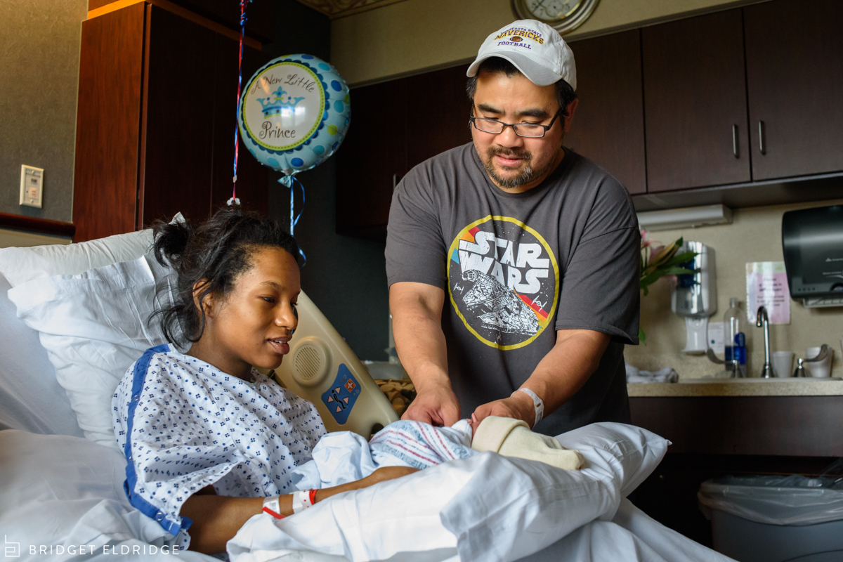 mom gives dad the baby at reston hospital center