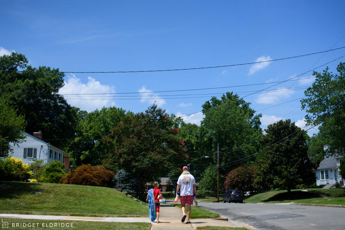 father and sun walk to the pool in the waynewood neighborhood in alexandria