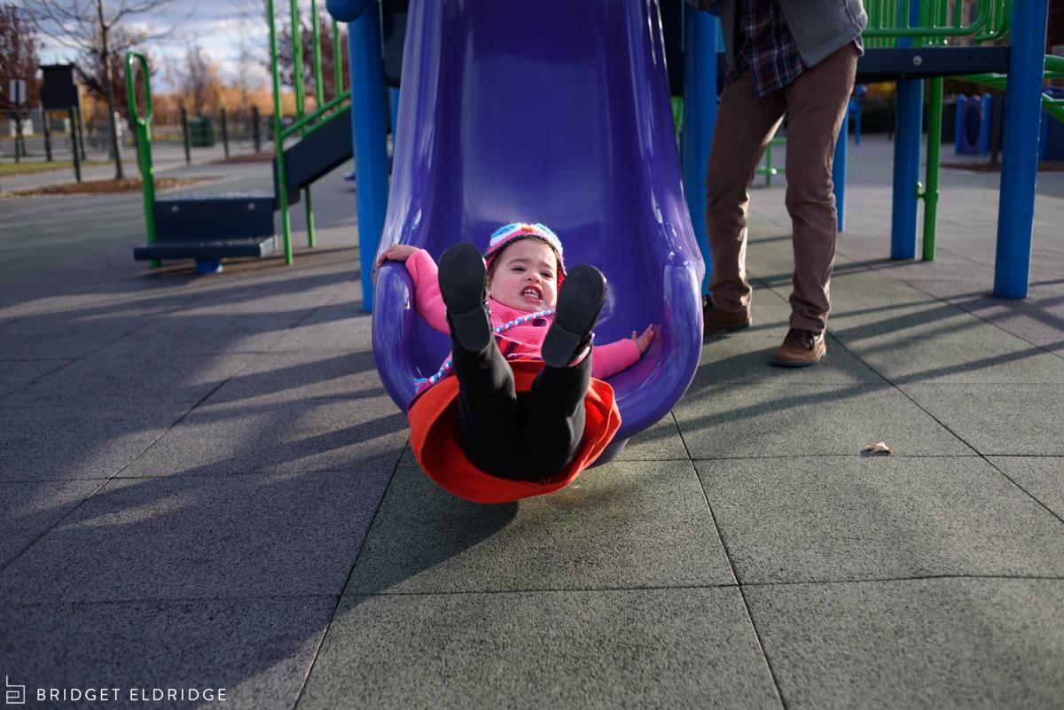 toddler flies off the slide