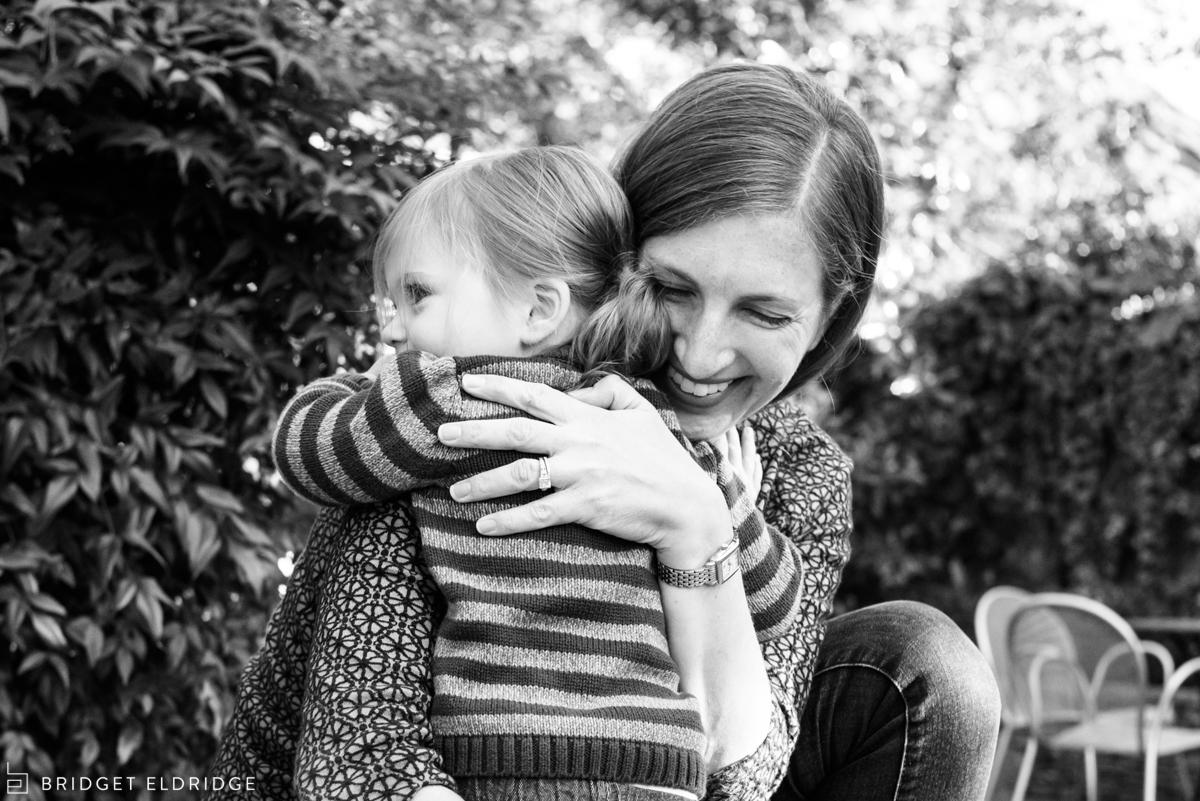 toddler hugs her mom