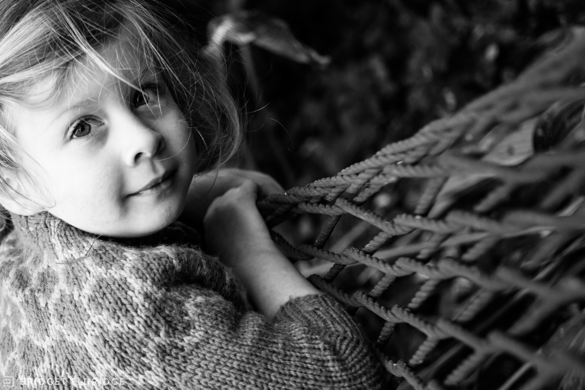 environmental portrait of a girl on a hamock