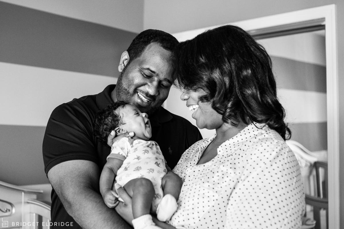 newborn smiles at her parents