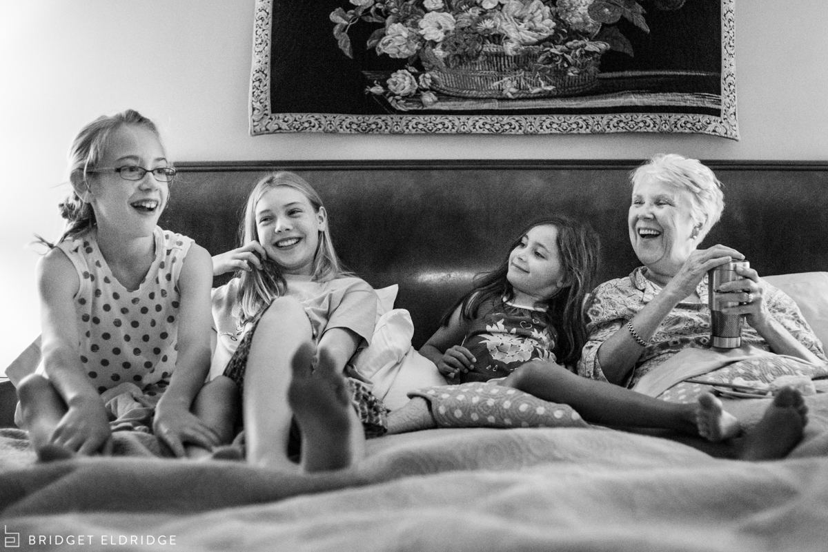 grandmother laughs with her granddaughters
