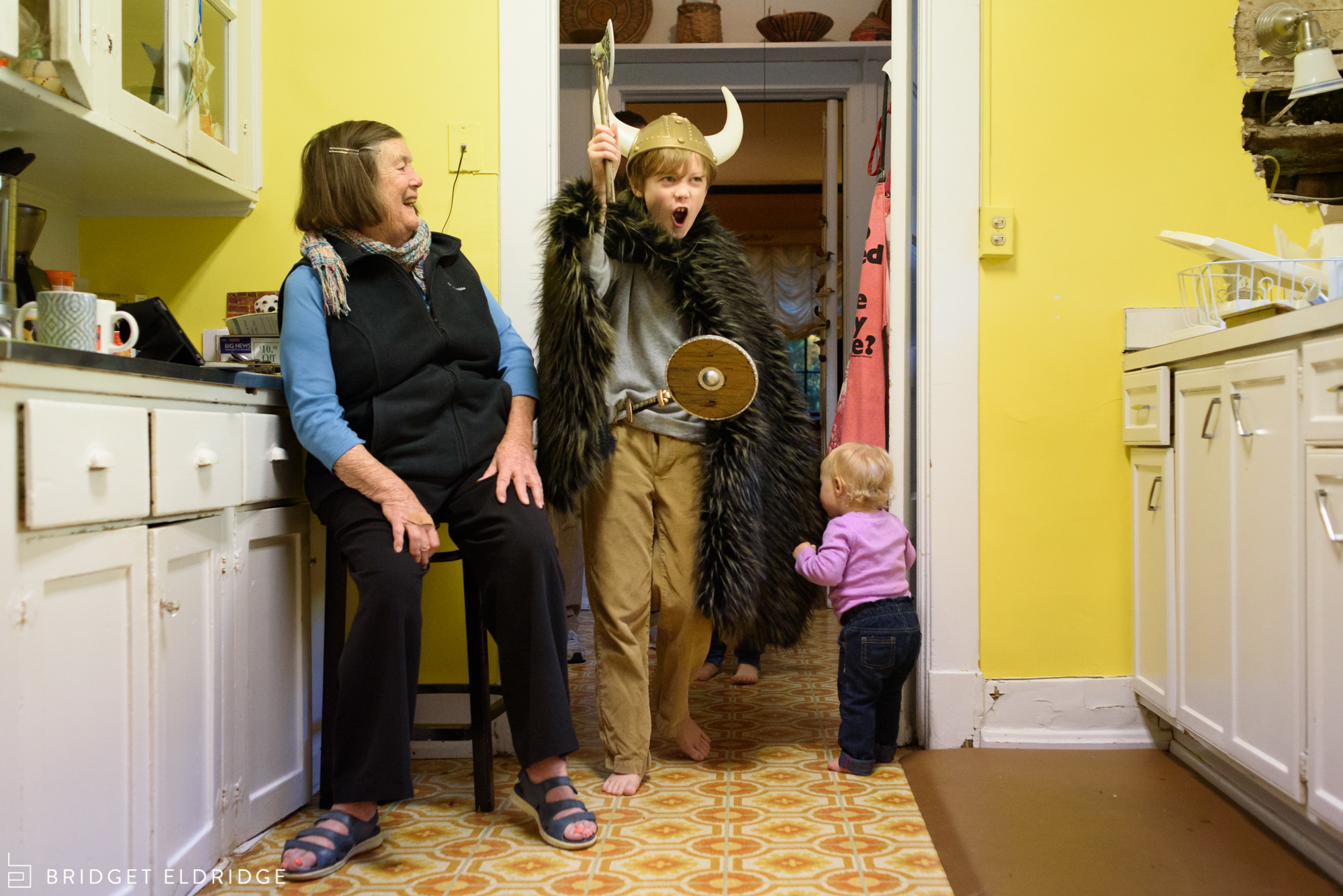 boy shows his grandmother his viking costume