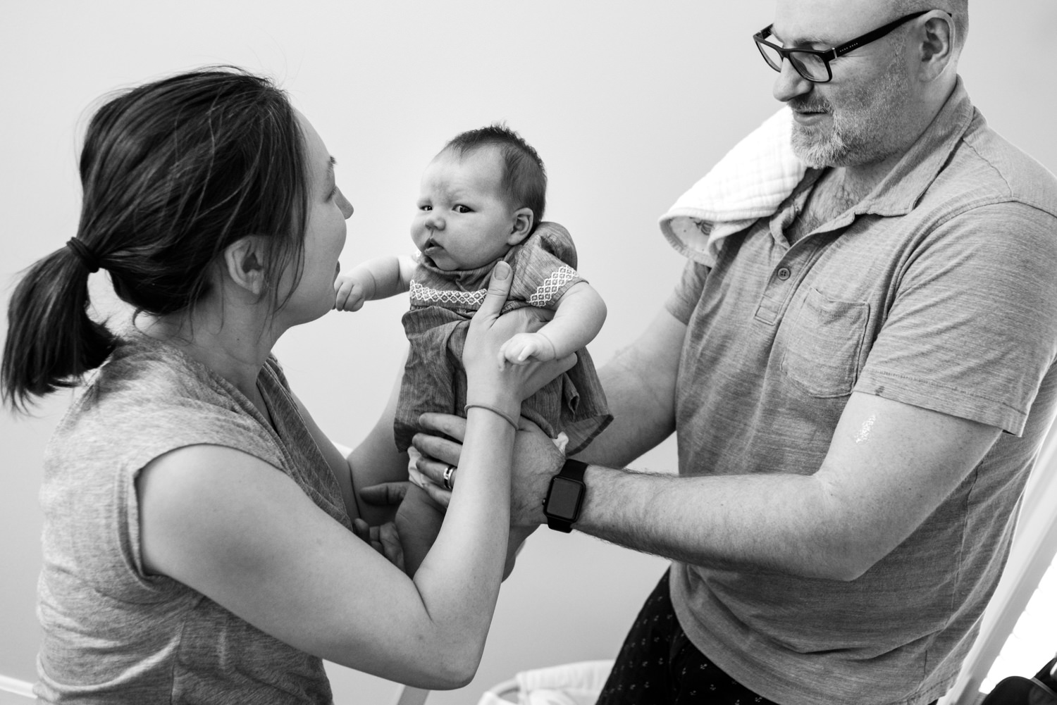 mom and dad work together to take care of 3 month daughter in old town alexandria
