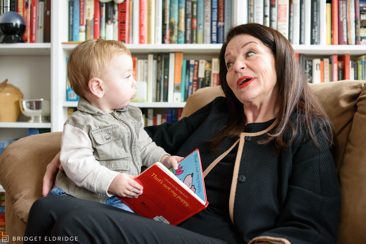 grandmother reads a book to her grandson