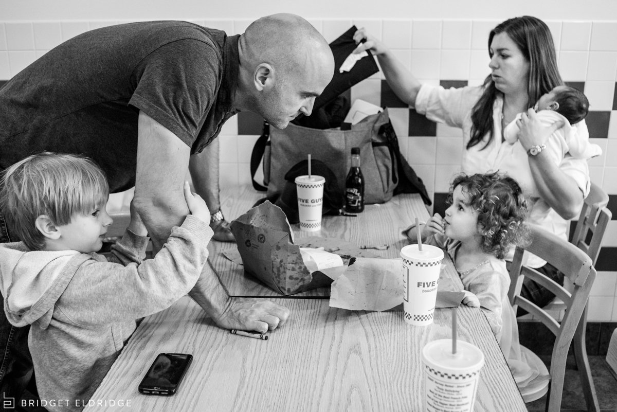 family packs up after eating at five guys