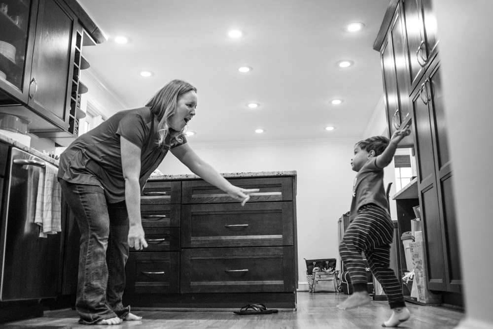 boy and his mom dance to moana in their kitchen