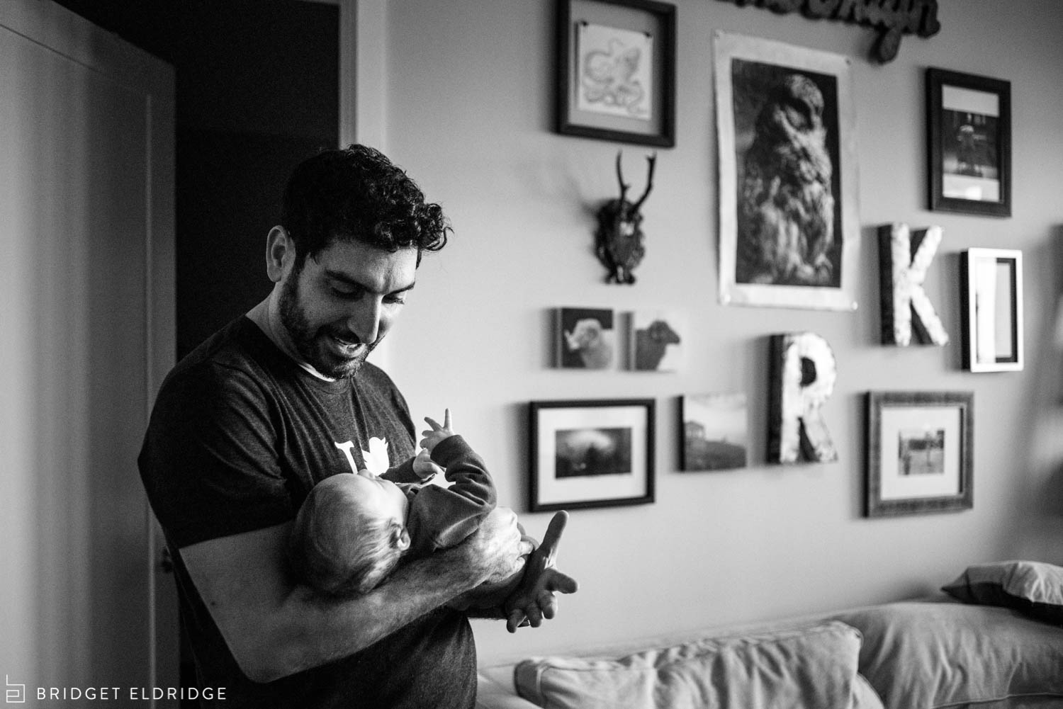 father plays with newborn son